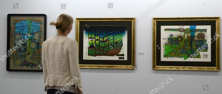 Aáwoman Stands in Front of Paintings by Austrian Artist Friedensreich Hundertwasser at the Kunsthalle Messmer in Riegel Germany 03 April 2014 the Exhibition 'Hundertwasser and Ernst Fuchs' Runs From 05 April to 14 September Germany Riegel