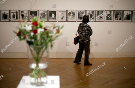 A Woman Looks at Portaits From the Series '100 Jahre' (100 Years) by Hans-peter Feldmann During the Exhibition of the Federal Republic of Germany's Contemporary Art Collection Acquisitions (from 2007 to 2011) at Bundeskunsthalle in Bonn Germany 17 January 2013 the Exhibition Runs From 18 January to 14 April 2013 Germany Bonn