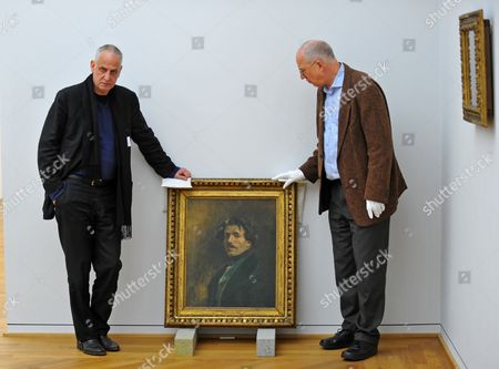 Museum Director Ulrich Bischoff (r) and Belgian Painter Luc Tuymans (l) Pose Next to a Self Portrait From 1837 of Eugene Delacroix (1798-1863) at Albertinum in Dresden Germany 08 March 2013 the Exhibition 'The Convulsion of the Senses' Will Run From 16 March Till 14 July 2013 Displaying More Than 70 Paintings by Sixteen Artists Germany Dresden