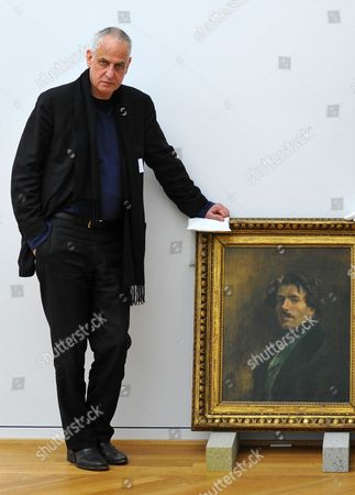Belgian Painter Luc Tuymans Poses Next to a Self Portrait From 1837 of Eugene Delacroix (1798-1863) at Albertinum in Dresden Germany 08 March 2013 the Exhibition 'The Convulsion of the Senses' Will Run From 16 March Till 14 July 2013 Displaying More Than 70 Paintings by Sixteen Artists Germany Dresden