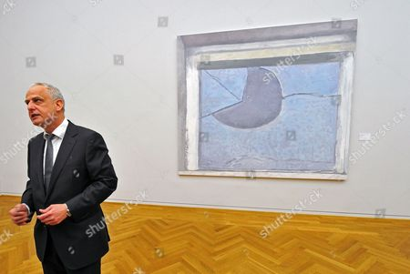 Belgian Artist Luc Tuymans Stands in Front of His Painitng 'Morning Sun' (2011) in a New Special Exhibition at the Albertinum in Dresden Germany 15 March 2013 the Artwork is Presented in Exhibition 'The Convulsion of the Senses' Which Will Run From 16 March to 14 July Displaying More Than 70 Paintings by Sixteen Artists Germany Dresden