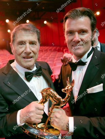 Austrian Composer and Singer Udo Jurgens (l) Next to His Son John Jurgerns Pose For a Picture with a Bambi in the Category 'Lifetime Achievement' During the 65th Bambi Award Ceremony at the Stage Theater in Berlin Germany 14 November 2013 the Burda Media Prizes Are Awarded in 17 Categories at the Stage Theater Germany Berlin