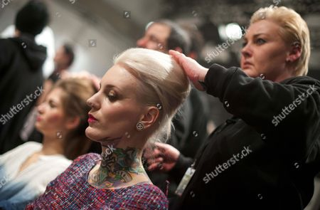 Austrian-born Tattoo Model Lexy Hell (l) Gets Prepared For the Anja Gockel Show During the Mercedes-benz Fashion Week in Berlin Germany 16 January 2013 the Presentations of the Fall-winter 2013/2014 Collections Takes Place at the Mercedes-benz Fashion Week Berlin From 15 to 18 January Germany Berlin