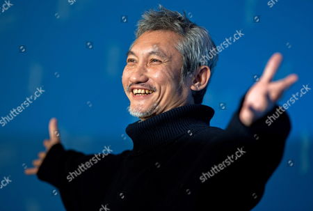 Chinese Director Tsui Hark Poses at a Photocall For His Movie 'The Flying Swords of Dragon Gate' During the 62nd Berlin International Film Festival in Berlin Germany 17 February 2012 the Movie is Presented out of Competition at the 62nd Berlinale That Runs From 09 to 19 February Germany Berlin