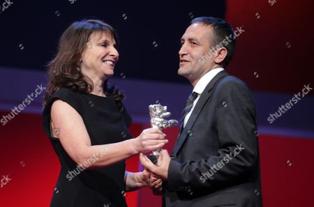 Bosnian Actor Nazif Mujic (r) Receives the Silver Bear Award For Best Actor For His Performance in the Movie 'An Episode in the Life of an Iron Picker' ('epizoda U Zivotu Beraca Zeljeza') From Jury Member Danish Director Susanne Bier (l) During the Closing Ceremony of the 63rd Annual Berlin International Film Festival in Berlin Germany 16 February 2013 the Berlinale Runs From 07 to 17 February Germany Berlin