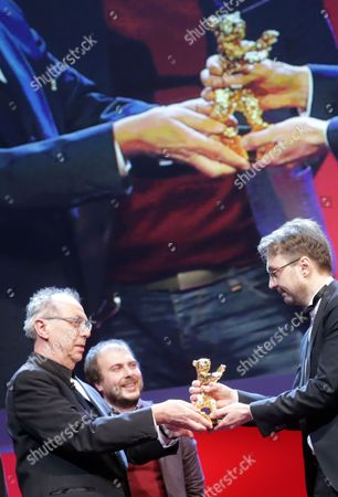 Romanian Director Calin Peter Netzer (r) Receives the Golden Bear Award For Best Film For His Movie 'Child's Pose' (pozitia Copilului) From Festival Director Dieter Kosslick (l) During the Closing Ceremony of the 63rd Annual Berlin International Film Festival in Berlin Germany 16 February 2013 the Berlinale Runs From 07 to 17 February Germany Berlin