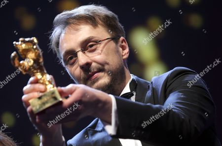 Romanian Director Calin Peter Netzer Receives the Golden Bear For Best Film For His Movie 'Child's Pose' (pozitia Copilului) During the Closing Ceremony of the 63rd Annual Berlin International Film Festival in Berlin Germany 16 February 2013 the Berlinale Runs From 07 to 17 February Germany Berlin