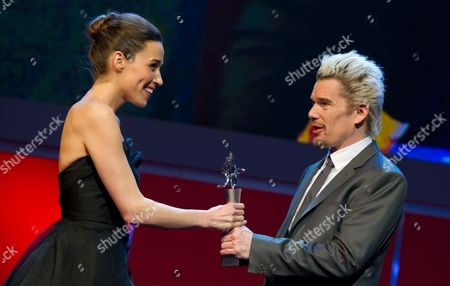 Kosovar Actress Arta Dobroshi (l) Receives the Shooting Star 2013 Trophy From Us Actor Ethan Hawke (r) During the 63rd Annual Berlin International Film Festival in the Berlinale Palace in Berlin Germany 11 February 2013 the Berlinale Runs From 07 to 17 February Germany Berlin