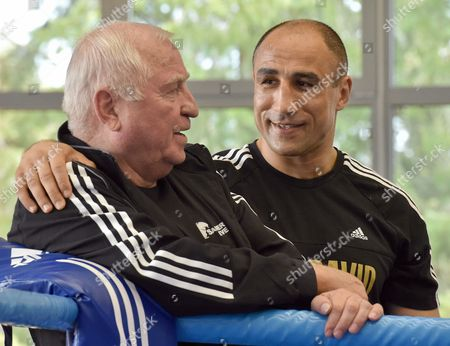 Wboáworld Champion Arthur Abraham (r) Talks with His Coach Ulli Wegner During the Press Training Session at the National Training Centre in Kienbaum Germany 23 April 2014 He Will Fight Montenegro's Sjekloca to Defend His Wboásuper Middleweight Title in Berlin on 03 May 2014 Germany Kienbaum