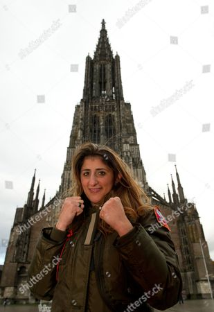 German Boxer Rola El-halabi Poses For Photographers in Front of the Gothic Minister in Ulm Germany 05 November 2012 Lebanese-born El-halabi who was Shot by Her Stepfather in Her Hand Knee and Both Feet on 01 April 2011 Will Celebrate Her Boxing Comeback with a Fight Against Lucia Morelli on 12 January 2013 Germany Ulm
