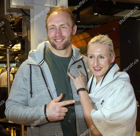 German Discus Thrower Robert Harting and Pole Vaulter Ariane Friedrich Pose During the Opening of the New Nike Store in Berlin Germany 14 February 2014 Nike's New Flagship Store Occupies 2 600 Square Metres on Three Stories Germany Berlin