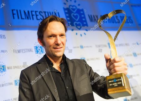 Austrian Filmmaker Rainer Frimmel Holds His Award During the Max Ophuels Award Ceremony at E-werk in Saarbruecken Germany 26 January 2013 Frimmel was Awarded For His Movie 'Der Glanz Des Tages' the 34th Max Ophuels Film Festival Takes Place From 21 to 27 January Germany Saarbruecken