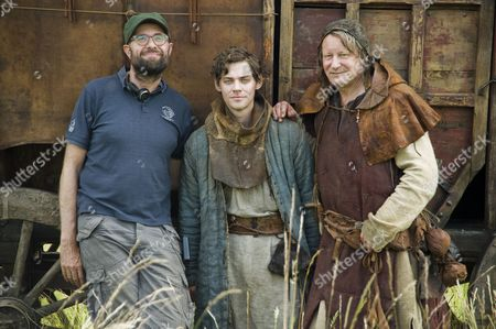 German Director Philipp Stoelzl (l-r) British Actor Tom Payne (l) As Orphan Rob Cole and Swedish Actor Stellan Skarsgard As Barber Pose During the Filming of the Novel 'The Physician' in Elbingerode Germany 04 July 2012 the Movie Will Be Filmed For 13 Days in Germany and is Scheduled to Come to German Cinemas For Christmas 2013 Germany Elbingerode
