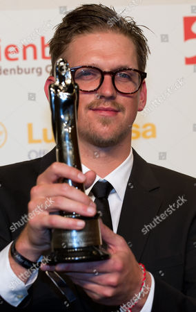 German Director Jan Ole Gerster Poses with His European Discovery Award After the 26th European Film Awards Ceremony in Berlin Germany 07 December 2013 Germany Berlin