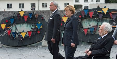 Bavarian Culture Minister Ludwig Spaenle (l-r) German Chancellor Angela Merkel and Holocaust Survivor Max Mannheimer Watch As a Wreath is Lain at the Concentration Camp Memorial in Dachau Germany 20 August 2013 Merkel's Visit to the Memorial Has Sparked Controversy She Visited the Concentration Camp Quickly Between Two Other Election Campaign Events in Erlangen and Dachau the German Federal Elections Will Be Held on 22 September 2013 Germany Dachau