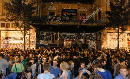 Several Thousand Visitors Listen to the External Transmission of a Concert of the Band Beginner with Jan Delay in Front of the 'Rote Flora' in Hamburg Germany 30 August 2014 the Concert Celebrated the 25th Anniversary of the Occupation of the Current Cultural Center 'Rote Flora' (lit : Red Flora) a Former Theater That Has Been Squatted Since 1989 Germany Hamburg