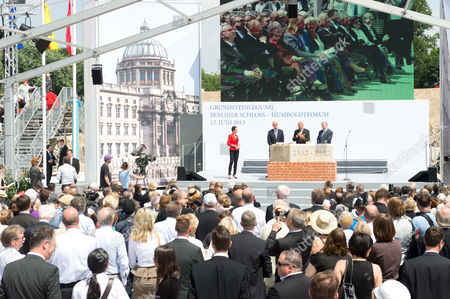 Federal Government Commissioner For Culture and the Media Bernd Neumann (c Cdu) Together with Peter Ramsauer Federal Secretary of Housing and Urban Development and Berlin Mayor Klaus Wowereit (r Spd) Speak on the Stage (background) at the Laying of the First Stone For the Berlin Palace in Berlin Germany 12 June 2013 Germany Berlin