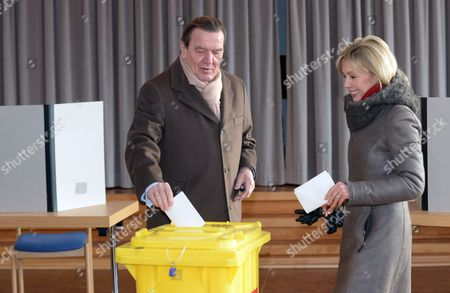 Former German Chancellor Gerhard Schroeder (c) and His Wife Doris Schroeder-koepf (r) Cast Their Ballots For the Lower Saxony State Elections at a Polling Station in Hanover Germany 20 January 2013 Some 6 1 Million Eligible Voters Were Casting Ballots 20 January in the Key German State of Lower Saxony with the Race Neck-and-neck Between the Ruling Coalition of German Chancellor Angela Merkel and the Centre-left Opposition the Election in the State That is Home to Volkswagen and Many Small Industries is Seen As a Test of the German General Election Expected in September Germany Hanover
