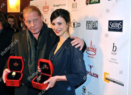 German Actors Ben Becker (l) and Aylin Tezel Show Their Askania Awards 2013 in Berlin Germany 05 February 2013 Germany Berlin