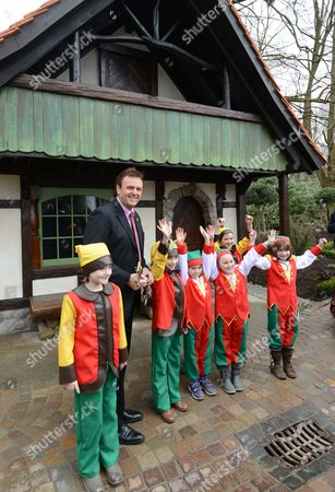 Europapark Ceo Roland Mack and Seven Children Stand in Front of a House Performing a Scene of Snow White and the Seven Dwarfs at Europapark in Rust Germany 21 March 2013 Germany's Largest Theme Park Will Focus on the Brothers Grimm This Year Germany Rust