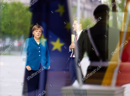 Stock Image of German Chancellor Angela Merkel Waits For the Arrival of President of the European Parliament Martin Schulz with Nikolaus Meyer-landrut (2-r) Head of the European Policy Division at the Federal Chancellery in Berlin Germany 08 May 2012 Merkel Met Schulz For Talks at the Federal Chancellery Germany Berlin