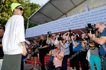 German Singer Alina Sueggeler (l) Poses For Photographers As He Arrives For the Escada Sport Show During the Mercedes-benz Fashion Week in Berlin Germany 04 July 2012 the Presentation of the Spring/summer 2013 Collections Takes Place From 04 to 07 July 2012 Germany Berlin