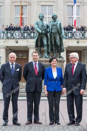 Foreign Ministers Laurent Fabius of France (l-r) Radoslaw Sikorski of Poland Premier of Federal State Thuringia Christine Lieberknecht and German Foreign Minister Frank-walter Steinmeier Stand in Front of the Goethe-schiller-statue in Front of the German National Theatre in Weimar Germany 31 March 2014 at the Weimar Triangle Annual Meeting the Foreign Ministers Discussed the Crimean Crisis Amongst Other Topics Germany Weimar