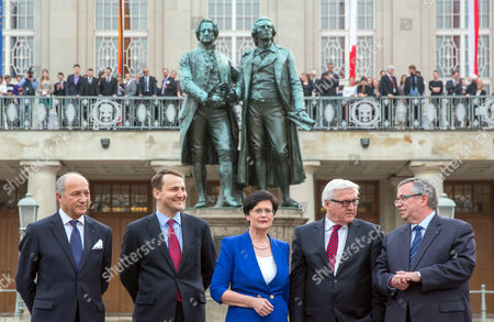 Foreign Ministers Laurent Fabius of France (l-r) Radoslaw Sikorski of Poland Premier of Federal State Thuringia Christine Lieberknecht German Foreign Minister Frank-walter Steinmeier and Weimar Mayor Stefan Wolf Stand in Front of the Goethe-schiller-statue in Front of the German National Theatre in Weimar Germany 31 March 2014 at the Weimar Triangle Annual Meeting the Foreign Ministers Discussed the Crimean Crisis Amongst Other Topics Germany Weimar