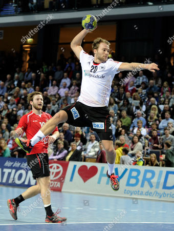 Stock Image of Germany's Kevin Schmidt (r) Throws the Ball During the International Handball Match Between Germany and Switzerland at Rittal Arena in Wetzlar Germany 09 March 2013 Germany Wetzlar