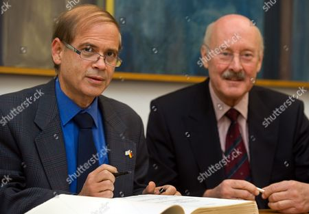 Israeli Ambassador to Germany Yakov Hadas-handelsman (l) and the President of the European University Viadrina Gunter Pleuger Sit in Front of a Guest Book at the University of Frankfurt/oder in Germany 12 December 2012 Under the Motto 'Israel@viadrina' Different Discussions with Experts From Politics and Science Take Place Germany Frankfurt (oder)