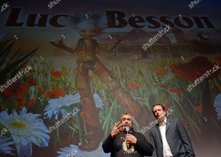 French Director Luc Besson (l) Speaks Next to Managing Director of Europa Park Roland Mack in a Cinema at the Leisure Park 'Europa Park' in Rust Germany 09 December 2013 Besson Presented the New Leisure Ride 'Arthut in the Kingdom of the Invisibles' Germany Rust