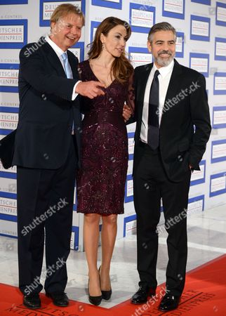The Laureate of the German Media Prize 2012 Us Actor George Clooney (r) Arrives with the Award's Sponsor Karlheinz Koegel (l) of Media Control and His Wife Dagmar Koegel (c) For the Awards Ceremony at the Conference Center of Baden-baden Germany 26 February 2013 Germany Baden-baden