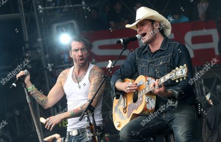 'Hoss Power' Aka Sascha Vollmer (r) and 'Boss Burns' Aka Alec Voelkel (l) of the German Country Rock Band 'Bosshoss' Perform at the Main Stage of 'Rock Am Ring' Music Festival at the Nuerburgring in Nuerburg Germany 08 June 2013 the Three-day Event Takes Place at the Famous Nuerburgring Motorsports Racetrack and is Considered to Be Germany's Biggest Open Air Rock Festival Germany Nuerburg