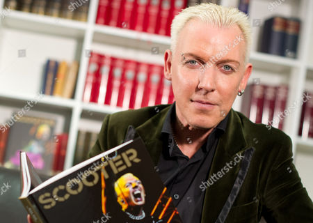 The Singer of German Band Scooter H P Baxxter Holds Up His Book 'Scooter: Always Hardcore' After an Interview in Berlin Germany 13 December 2013 Germany Berlin