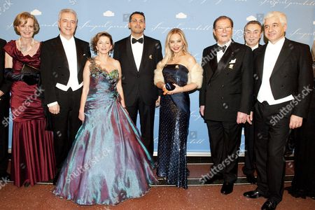 (l-r) Director of the Semper Opera Ulrike Hessler Saxony's President Stanislaw Tillich (cdu) Veronika Tillich Emiriti Businessman Khaldoon Khalifa Al Mubarak Italian Actress Ornella Muti British Actor Roger Moore Second Chairman of the Ball Bernd Aust and First Chairman of the Ball Hans-joachim Frey Pose at the 7th Semper Opera Ball in Dresden Germany 20 January 2012 According to Reports Over 2 200 Guests Attended the Event Germany Berlin