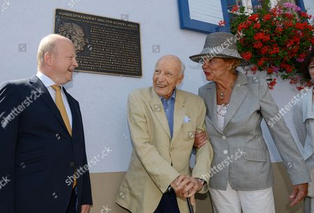 Former German President Walter Scheel (c) His Wife Barbara (r) and the Chairman of the Fdp of the State of Baden-wuerttemberg Michael Theurer (l) Stand in Front of a Board with the Writing 'Federal President Walter Scheel House' in Bad Krozingen Germany 16 July 2014 Since 2009 Fdp Politician Scheel Had His Office in a Three-storeyed Building the Office of the Federal President Asked Him to Leave His Office by 01 August Because He Doesn't Use It Anymore in His Old Age Germany Bad Krozingen
