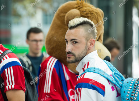 Bayern Munich's Diego Contento Stands at a Flight Desk at Munich Airport in Munich Germany 30 July 2014 German Bundesliga Soccer Club Fc Bayern Munich Are on Their Way to a Training Camp and Friendly Matches in the Usa Until 06 August 2014 á Germany Munich
