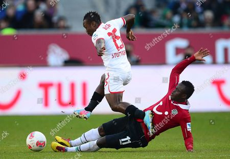 Hanover's Didier Ya Konan (r) Tackles Stuttgart's Arthur Boka (l) During the German Bundesliga Soccer Match Between Hanover 96 and Vfb Stuttgart in Hanover Germany 07 April 2013 (attention: Embargo Conditions! the Dfl Permits the Further Utilisation of Up to 15 Pictures Only (no Sequential Pictures Or Video-similar Series of Pictures Allowed) Via the Internet and Online Media During the Match (including Halftime) Taken From Inside the Stadium And/or Prior to the Start of the Match the Dfl Permits the Unrestricted Transmission of Digitised Recordings During the Match Exclusively For Internal Editorial Processing Only (e G Via Picture Databases) Germany Hanover