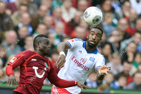 Hanover's Didier Ya Konan and Hamburg's Johan Djourou (r) Vie For the Ball During the Bundesliga Soccer Match Between Hanover 96 and Hamburger Sv at the Hdi Arena in Hanover Germany 12 April 2014 (attention: Due to the Accreditation Guidelines the Dfl Only Permits the Publication and Utilisation of Up to 15 Pictures Per Match on the Internet and in Online Media During the Match ) Germany Hanover