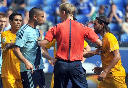 Referee Arne Aarnink (c) Mediates in a Confrontation Between West Ham's Winston Reid (2-l) and Malaga's Sergio Sanchez (r) During the Schalke Cup Soccer Test Match Between Fc Malaga and West Ham United Fc at Veltins-arena in Gelsenkirchen Germany 03 August 2014 Germany Gelsenkirchen