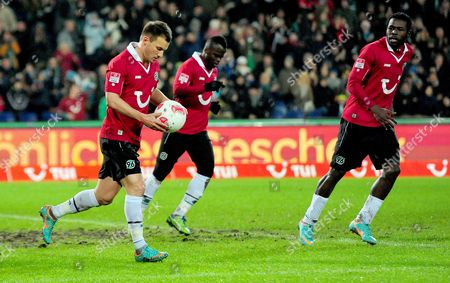 Hanover's Szabolcs Huszti (l) Celebrates with His Teammates Didier Ya Konan (c) and Mame Diouf (r) After Scoring the 1-1 Equalizer During the German Bundesliga Soccer Match Between Hanover 96 and Bayer 04 Leverkusen in Hanover Germany 09 December 2012 (attention: Embargo Conditions! the Dfl Permits the Further Utilisation of Up to 15 Pictures Only (no Sequential Pictures Or Video-similar Series of Pictures Allowed) Via the Internet and Online Media During the Match (including Halftime) Taken From Inside the Stadium And/or Prior to the Start of the Match the Dfl Permits the Unrestricted Transmission of Digitised Recordings During the Match Exclusively For Internal Editorial Processing Only (e G Via Picture Databases) Germany Hanover