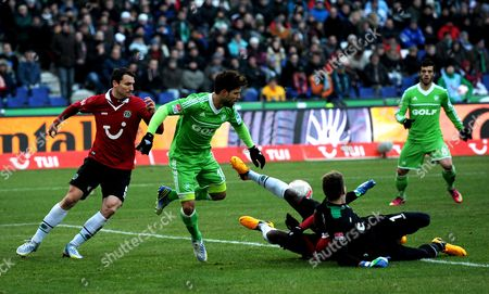 Hannover's Mario Eggimann (l) Goal Keeper Ron-robert Zieler (r on the Floor) and Johan Djourou Vie For the Ball with Wolfsburg's Diego (2-l) During the Bundesliga Soccer Match Between Hannobver 96 and Vfl Wolfsburg at Awd Arena in Hanover Germany 26 January 2013 (attention: Embargo Conditions! the Dfl Permits the Further Utilisation of Up to 15 Pictures Only (no Sequntial Pictures Or Video-similar Series of Pictures Allowed) Via the Internet and Online Media During the Match (including Halftime) Taken From Inside the Stadium And/or Prior to the Start of the Match the Dfl Permits the Unrestricted Transmission of Digitised Recordings During the Match Exclusively For Internal Editorial Processing Only (e G Via Picture Picture Databases) Germany Hanover