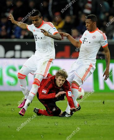 Munich's Luiz Gustavo (l) and Jerome Boateng (r) Vies For the Ball with Leverkusen's Stefan Kiessling (m) During the German Bundesliga Soccer Match Between Bayer Leverkusen and Fc Bayern Munich at Bayarena in Leverkusen Germany 16 March 2013 (attention: Embargo Conditions! the Dfl Permits the Further Utilisation of Up to 15 Pictures Only (no Sequential Pictures Or Video-similar Series of Pictures Allowed) Via the Internet and Online Media During the Match (including Halftime) Taken From Inside the Stadium And/or Prior to the Start of the Match the Dfl Permits the Unrestricted Transmission of Digitised Recordings During the Match Exclusively For Internal Editorial Processing Only (e G Via Picture Databases) Epa/marius Becker Germany Leverkusen