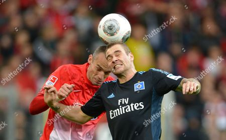 Freiburg's Pavel Krmas (l) Vies For the Ball with Hamburg's Paul Scharner (r) During the German Bundesliga Soccer Match Between Sc Freiburg and Hamburger Sv at the Mage Solar Stadium in Freiburg Germany 27 October 2013 (attention: Due to the Accreditation Guidelines the Dfl Only Permits the Publication and Utilisation of Up to 15 Pictures Per Match on the Internet and in Online Media During the Match ) Germany Freiburg