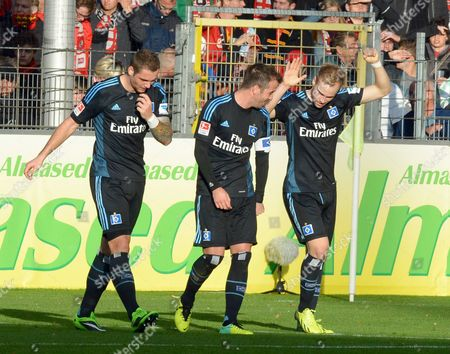 Hamburg's Paul Scharner (l-r) Rafael Van Der Vaart and Scorer Maximilian Beister Celebrate the 1-0 Goal During the German Bundesliga Soccer Match Between Sc Freiburg and Hamburger Sv at the Mage Solar Stadium in Freiburg Germany 27 October 2013 (attention: Due to the Accreditation Guidelines the Dfl Only Permits the Publication and Utilisation of Up to 15 Pictures Per Match on the Internet and in Online Media During the Match ) Germany Freiburg