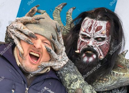 Stock Photo of German Presenter and Entertainer Stefan Raab (l) Poses with a Member of Finnish Hard Rock Band 'Lordi' During a Press Conference in Oberhof Germany 01 March 2013 the 'Tv Total Wok Champioship 2013' Will Take Place at the Oberhof Luge Track on 02 March 'Lordi' Will Compete in the Championship As Well As Perform As Musical Act Germany Oberhof