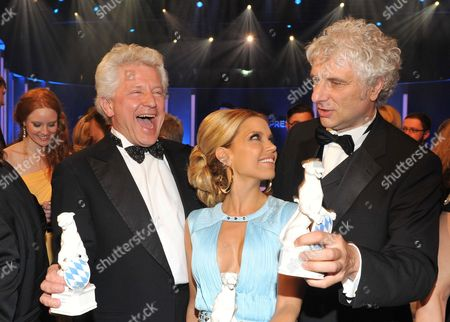 German Actors Udo Wachtveitl (r) and Miroslav Nemec (l) Pose with Their Prizes with Dutch Television Personality and Model Sylvie Van Der Vaart (c) During the Bavarian Television Awards Ceremony in Munich Germany 04 May 2012 the Bavarian Tv Award in the Form of a Panther Figure is Awarded Since 1989 Germany München