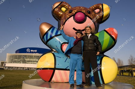 Brazilian Artist Romero Britto (l) Poses with Anthony Kennedy Shriver (r) Nephew of Us Politicians John F Robert and Ted Kennedy in Front of the Best Buddies Berlin Bear in Berlin Germany 11 November 2011 the Berlin Bear was Made by Britto and is a Gift From the Kennedys to Berlin Germany Berlin