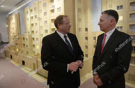 German Minister of Economic Cooperation and Development Dirk Niebel (l) Talks to the Ceo of the Company 'Bayti Real Estate' Bashar Al Masri in Front of a Scale Model of One of the Company's New Housing Projects in Nablus West Bank 08 December 2012 Niebel is Visiting Israel and the Palestinian Territories From 07 to 09 December 2012 - Nablus