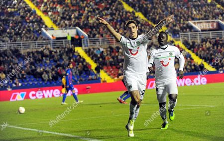 Hanover's Lars Stindl (l) Celebrates with His Teammate Didier Ya Konan (r) After Scoring the Opening Goal During the Uefa Europa League Group L Soccer Match Against Levante Ud at Ciutat De Valencia Stadium in Valencia Eastern Spain 06 December 2012 Spain Valencia